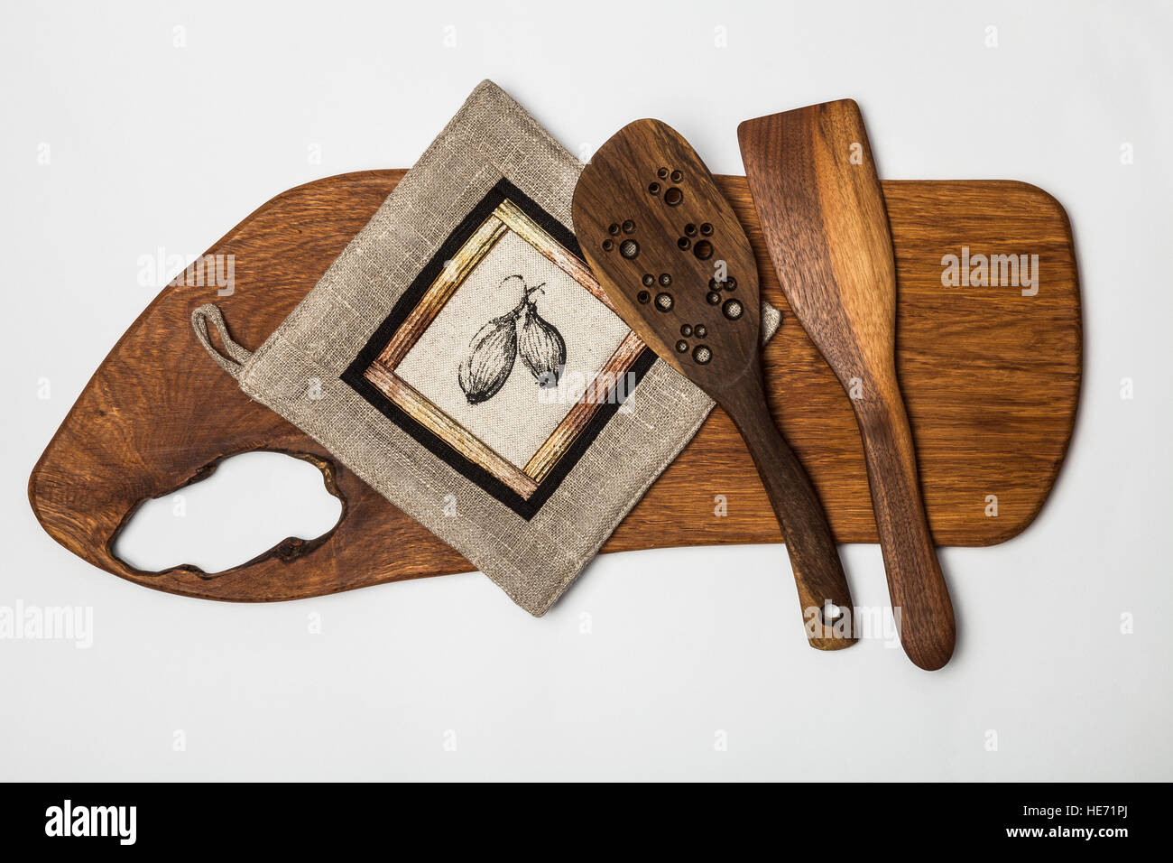 Kitchen equipment - wooden cutting table,tools and linen patchwork potholder. - Stock Image
