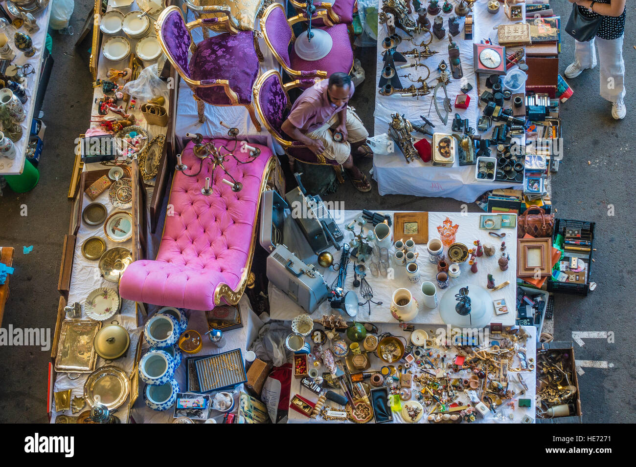 A view from above of an indoor flea market in Barcelona, Spain with an eclectic assortment of items for sale and Stock Photo