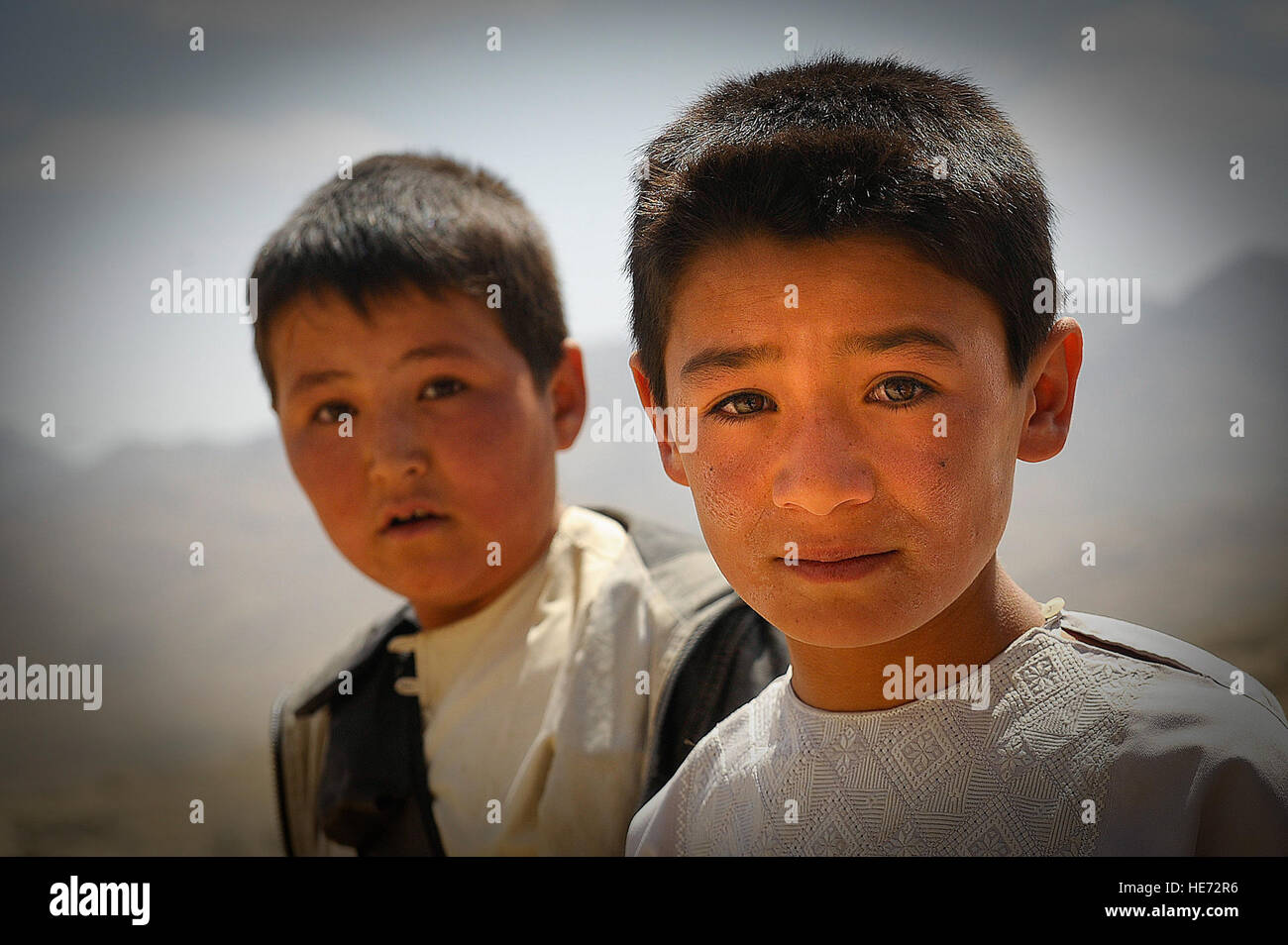 Afghan boys look on as ballot materials are unloaded from an Mi-17 helicopter in Jaghuri, Afghanistan, Sept. 16, - Stock Image