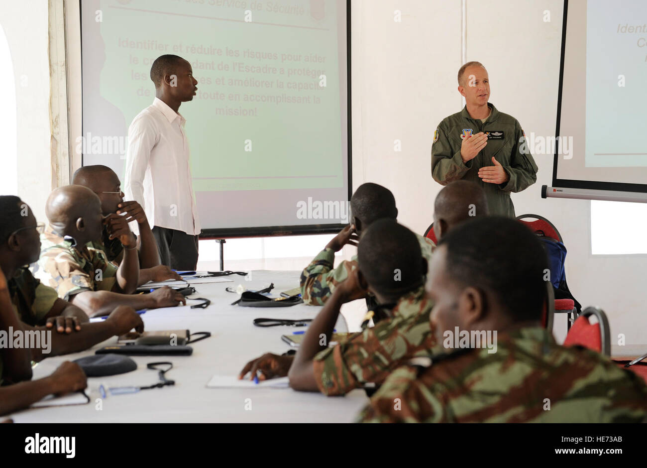 Lt. Col. Jeff Waldman, 129th Rescue Wing safety officer, instructs Airmen from multiple countries during African - Stock Image