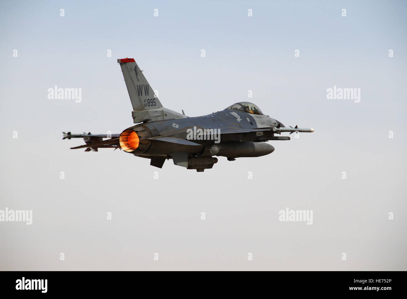An F-16 Fighting Falcon from the 13th Fighter Squadron at Misawa Air Base, Japan, takes to the skies over an air - Stock Image