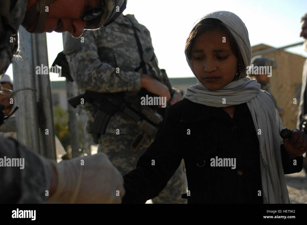 Afghan Dan an afghan girl receives medical treatment from lt. col. dan