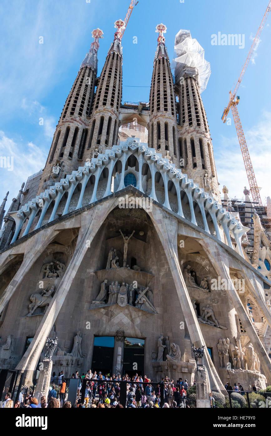 View of the towers of the Basílica i Temple Expiatori de la Sagrada Família that  is a large Roman Catholic - Stock Image