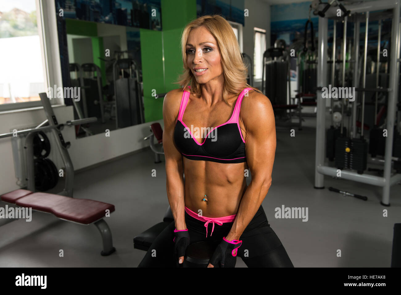 Old Mature Ass mature fitness woman working out ass in fitness center stock