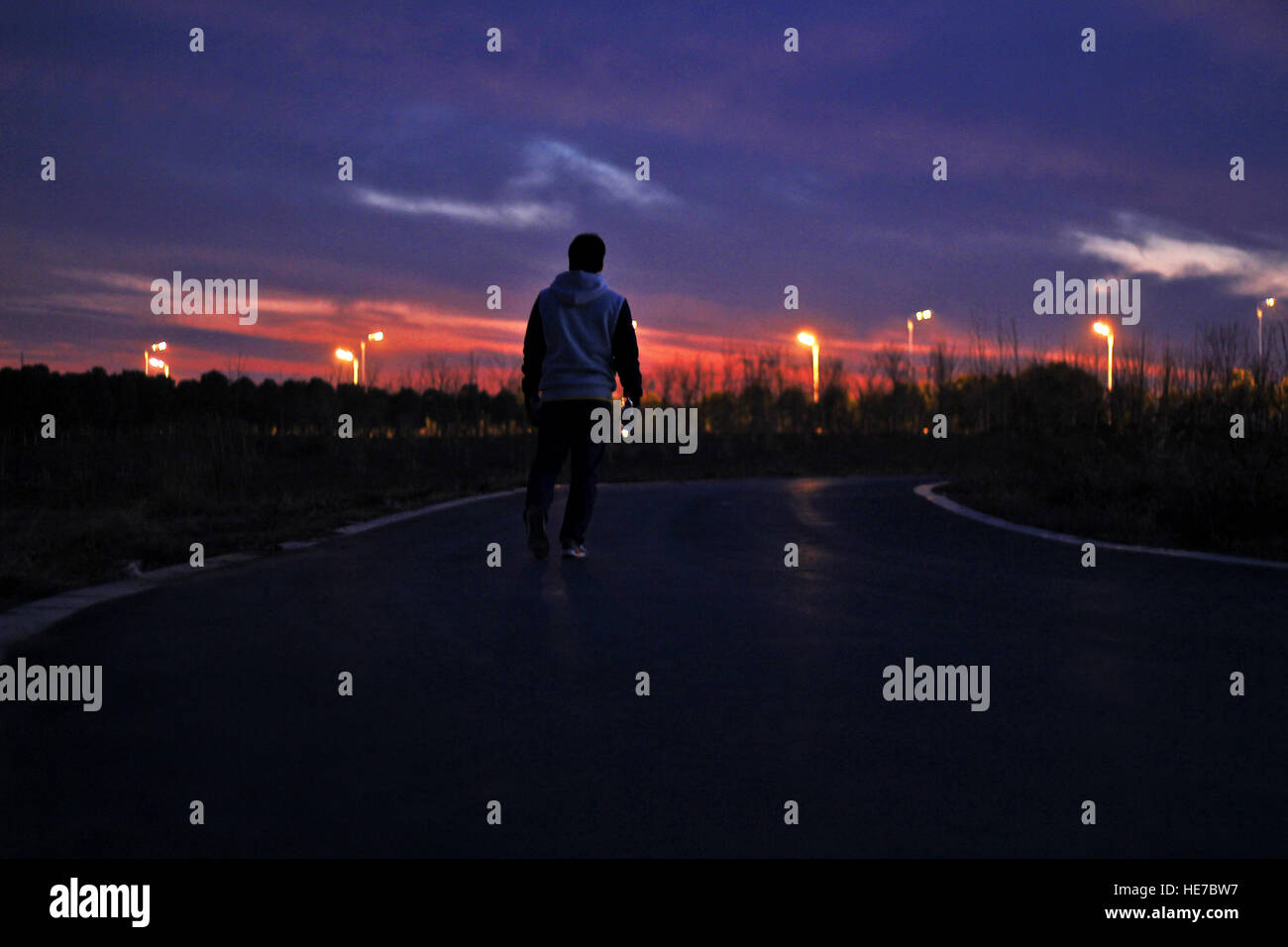 alone in sunset - Stock Image
