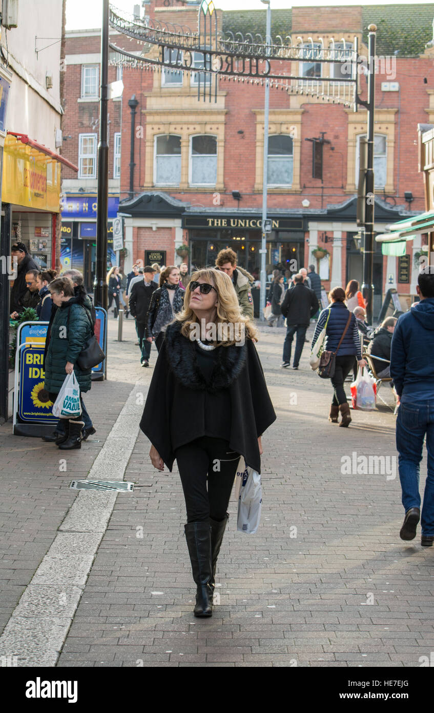 Female shopper in Churchgate pedestrianised shopping area in Loughborough Leicestershire - Stock Image