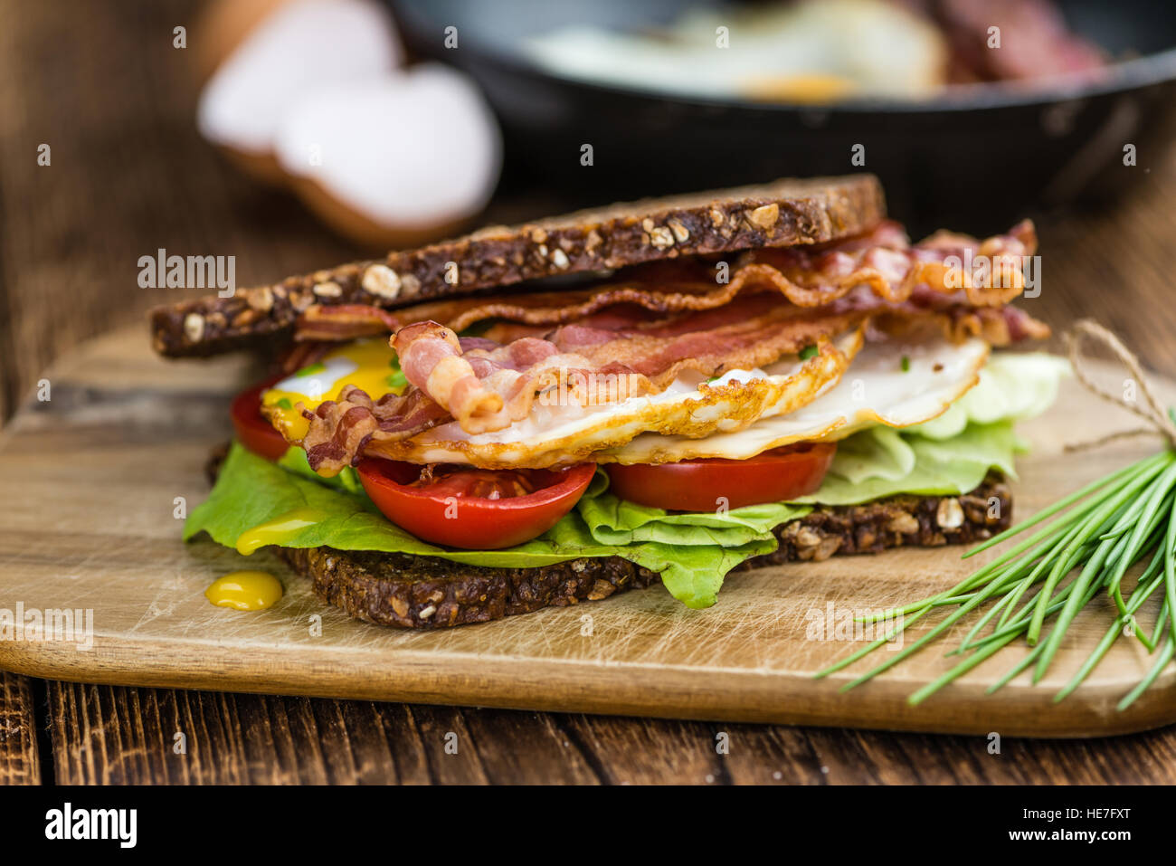 Portion of Bacon and Eggs (selective focus; close-up shot) - Stock Image