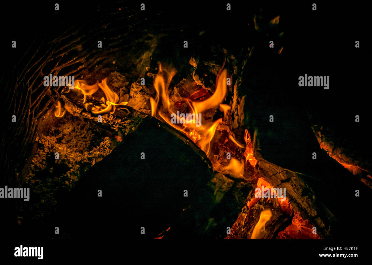 Flames and embers of a camp fire - Stock Image