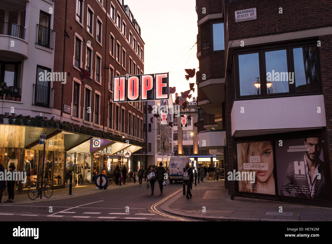 Street view of Broadwick street from Marshall street before entering in Carnaby street with big Christmas light - Stock Image