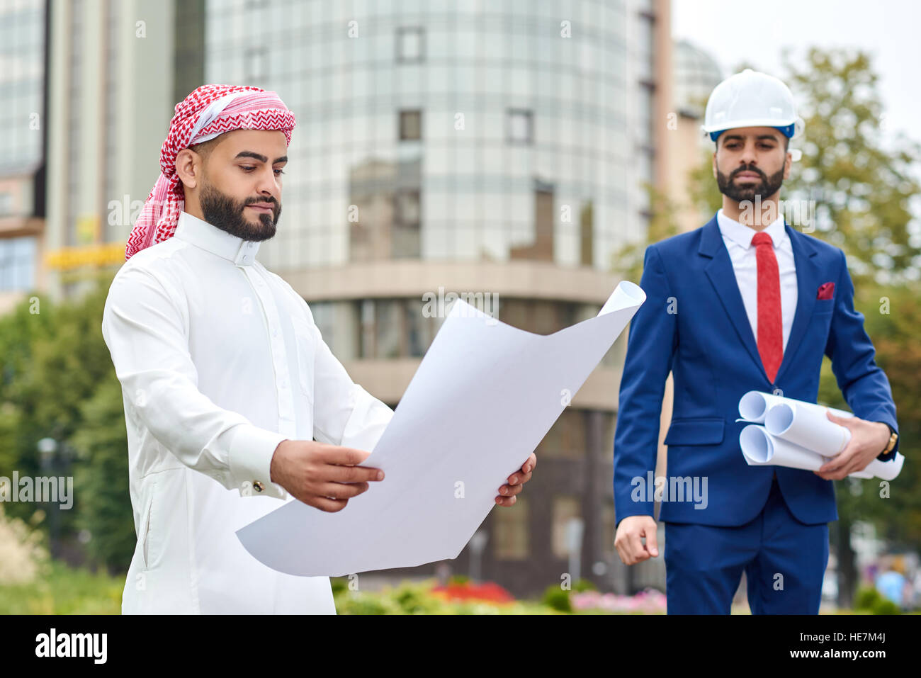 Almost all work is done. Shot of an Arab businessman examining architectural development plan - Stock Image