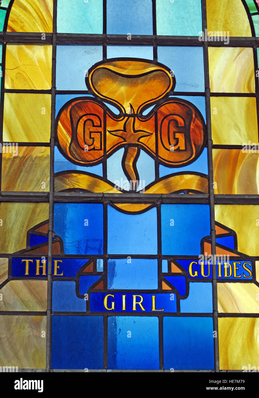 St Annes Belfast Cathedral Interior,The girl guides,stained glass window - Stock Image
