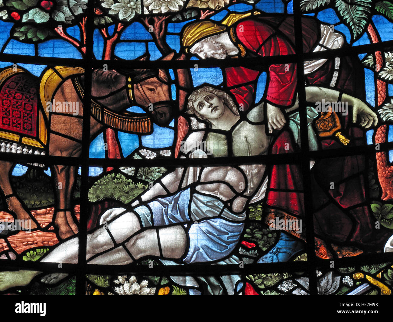 St Annes Belfast Cathedral Interior,Stained glass, Jesus,Donkey, taken down from the cross - Stock Image