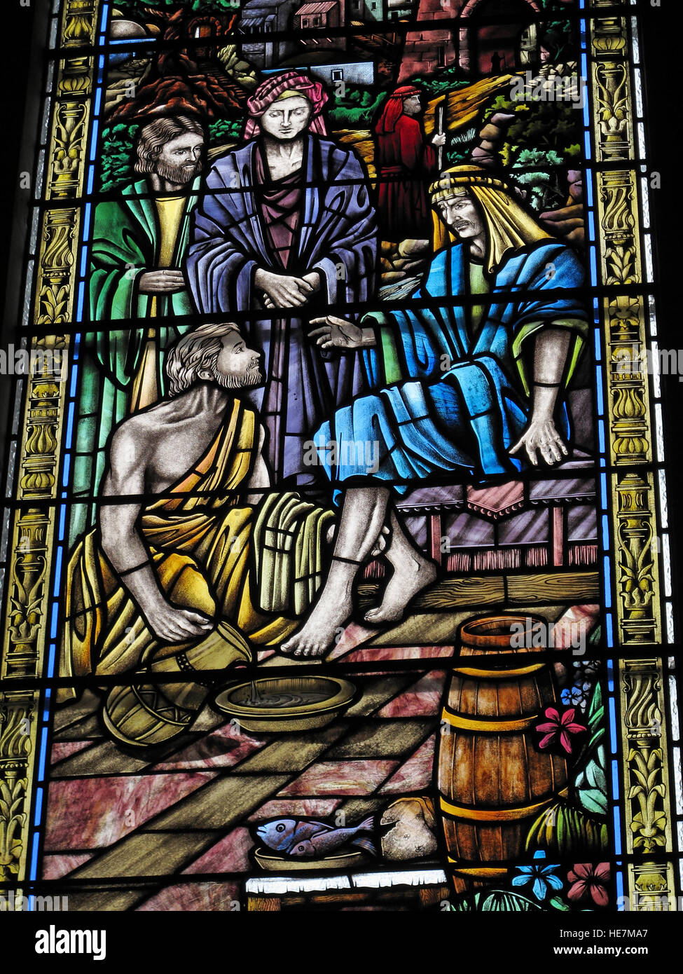 St Annes Belfast Cathedral Interior,Jesus washing feet,stained glass window - Stock Image