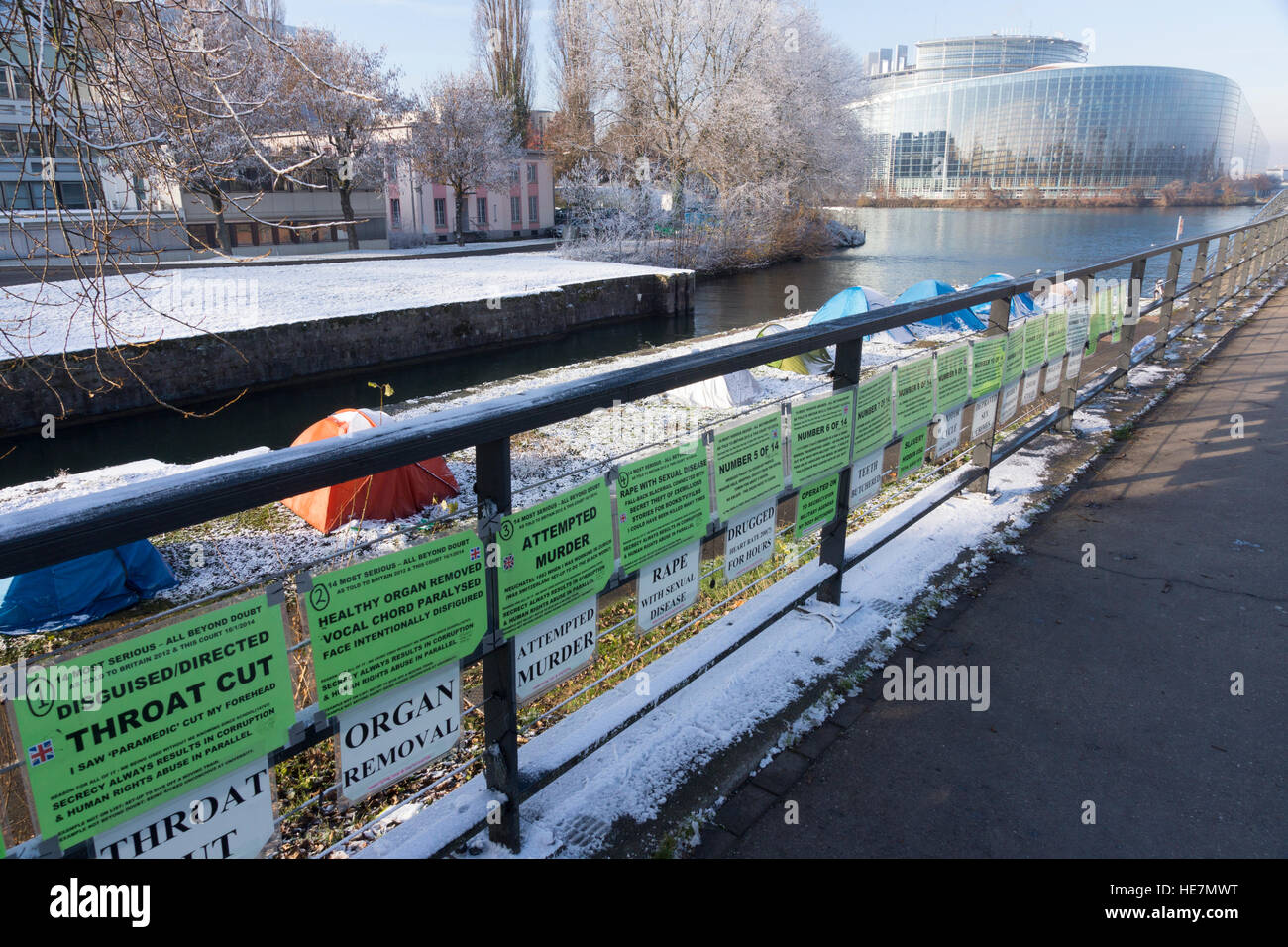 Protesters' signs and tents opposite the European Court of Human Rights and near the European Parliament Building - Stock Image