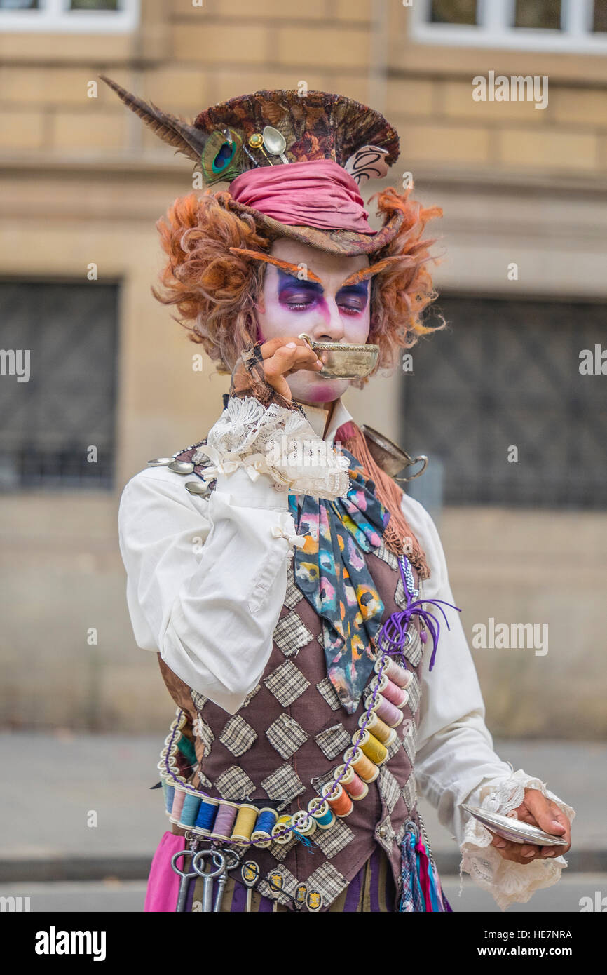 A male street performer, on Las Ramblas, in a homemade costume to look like the Mad Hatter from Alice in Wonderland, - Stock Image