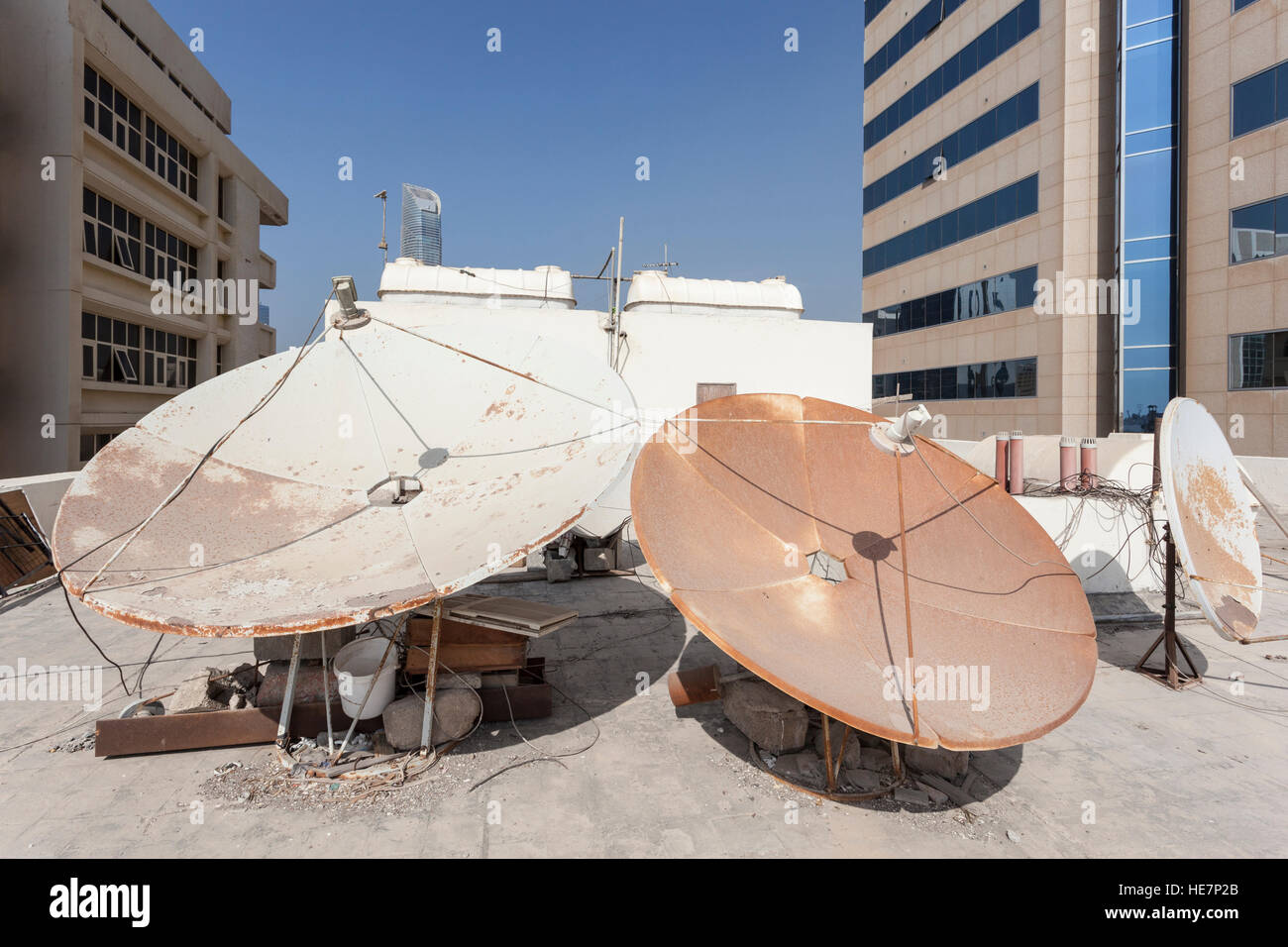 Satellite dish on the house roof - Stock Image