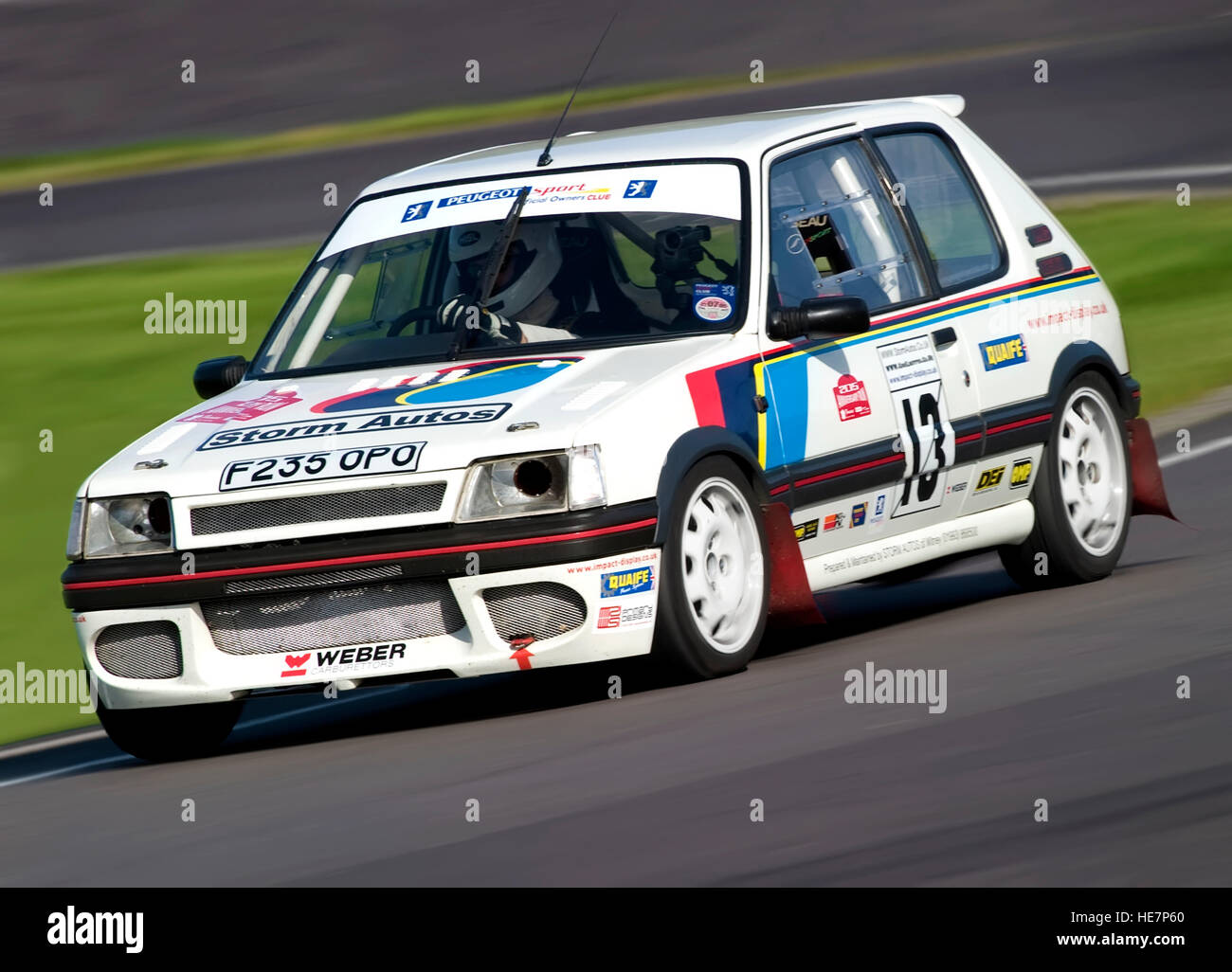 A Peugeot 205 1.6 GTI racing car at the Castle Combe Motor Racing ...