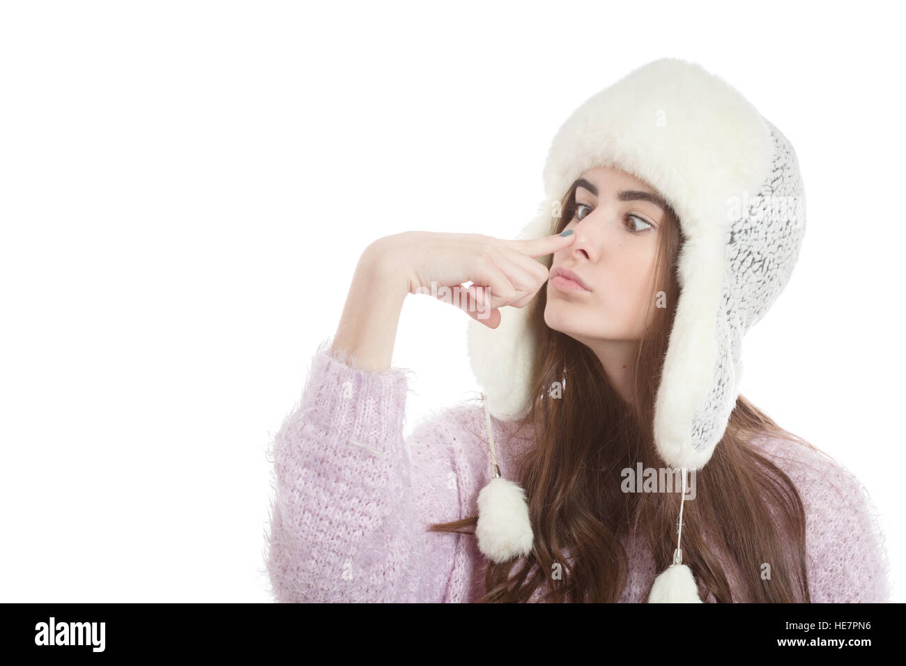 8d164745e9d fun girl in winter hat making nose isolated on white background - Stock  Image