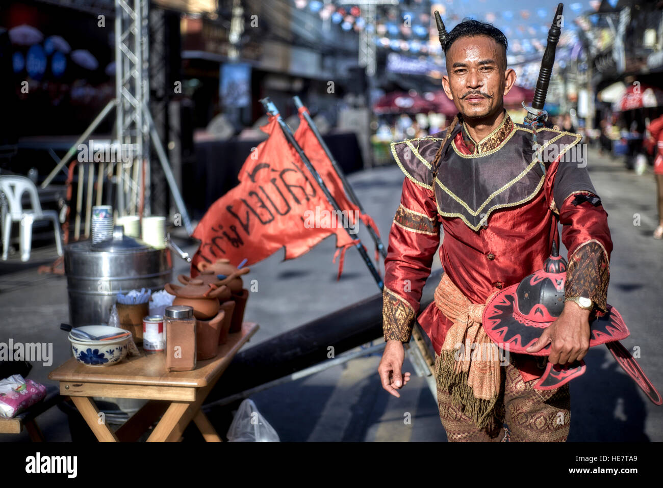 Thailand man dressed in traditional medieval ancient warrior costume during a Thailand street festival. S. E. Asia. - Stock Image