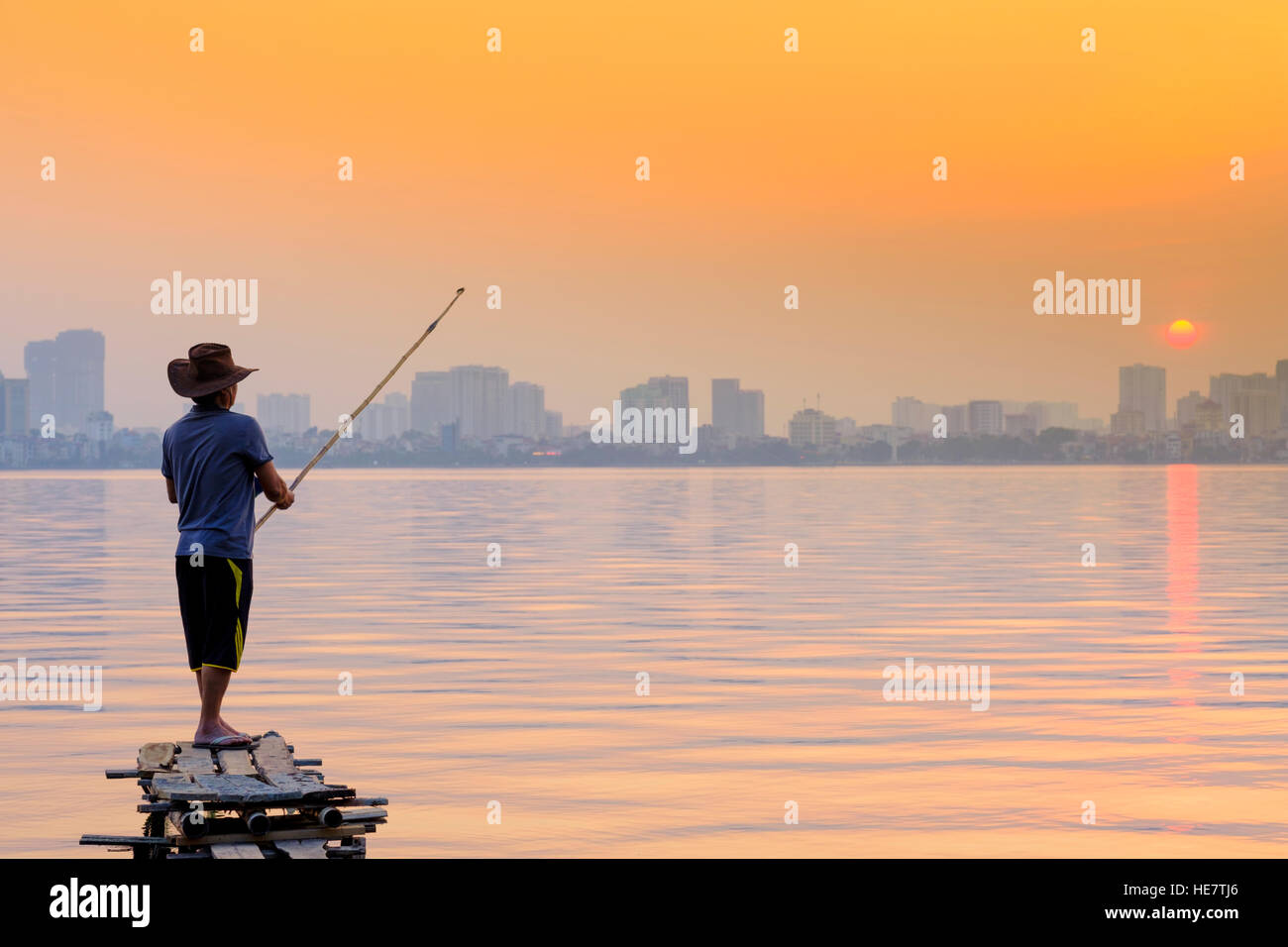 A man fishing on the West Lake in Hanoi, Vietnam Stock Photo