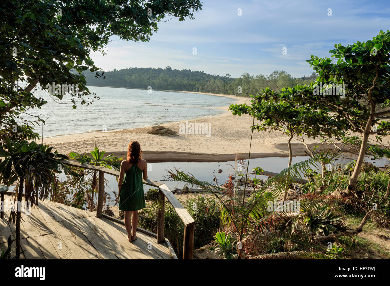 A young woman looks out over a deserted beach, Kaktus resort, Koh Ta Kiev, Sihanoukville, Cambodia - Stock Image