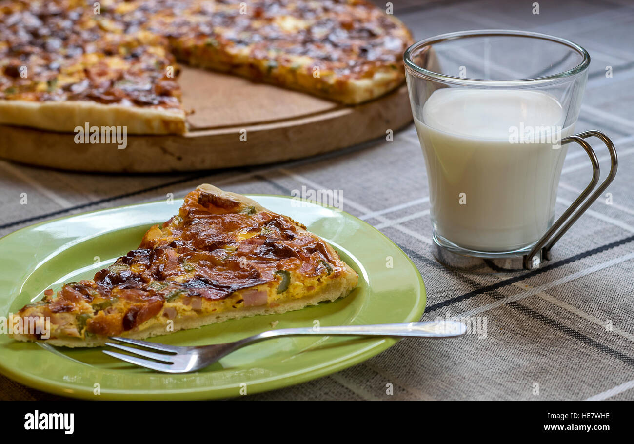 Homemade quiche (tart) with pickles, ham, prosciutto and cheese - Stock Image
