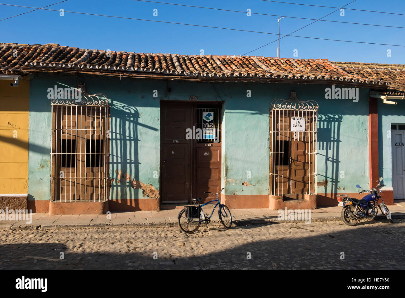 House for sale with traditional barred windows, Trinidad, Cuba - Stock Image
