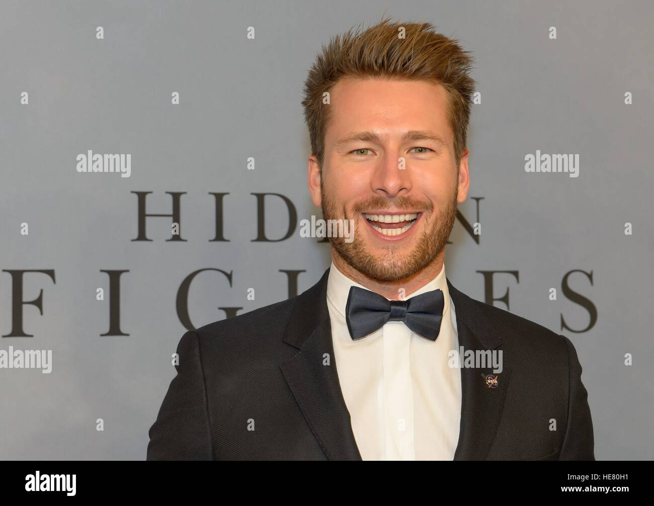 Actor Glen Powell walks the red carpet during the global celebration event for the film Hidden Figures at the SVA - Stock Image