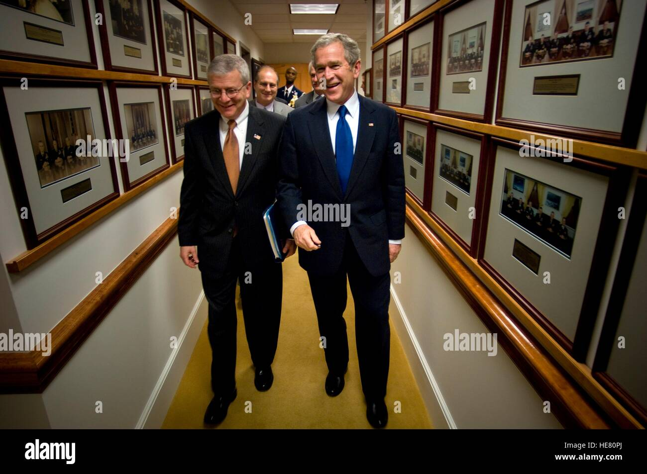 U.S. President George W. Bush and White House Chief of Staff Josh Bolton walk down a hallway after a military meeting - Stock Image