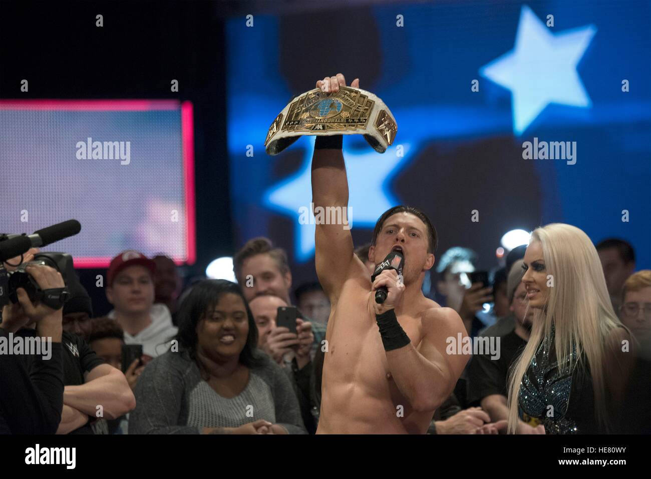 WWE performer The Miz holds up a championship belt after a wrestling match for the 14th Annual Tribute to the Troops - Stock Image