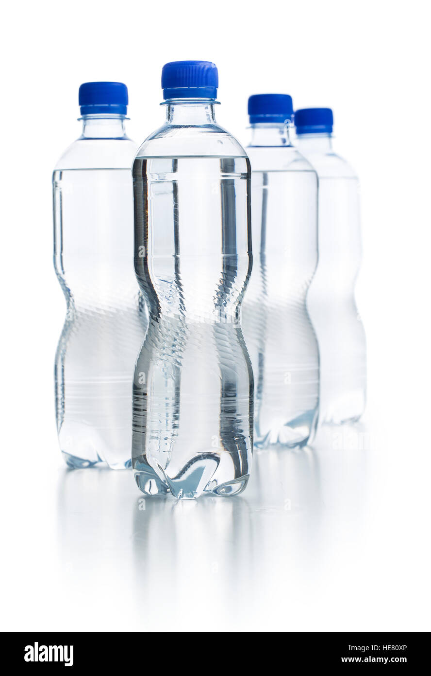 Small plastic water bottle isolated on white background. - Stock Image