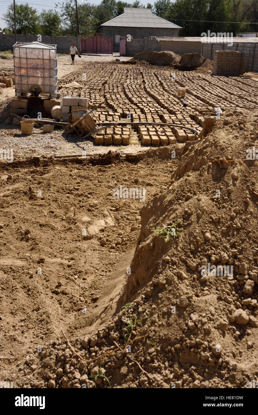 Onsite mudbrick manufacture for mud brick home construction near Shymkent Kazakhstan - Stock Image