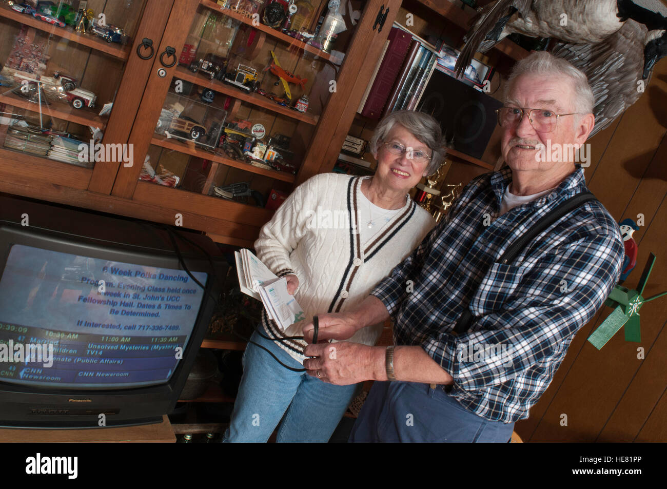 Couple frustrated with exorbitant cable tv bills - Stock Image