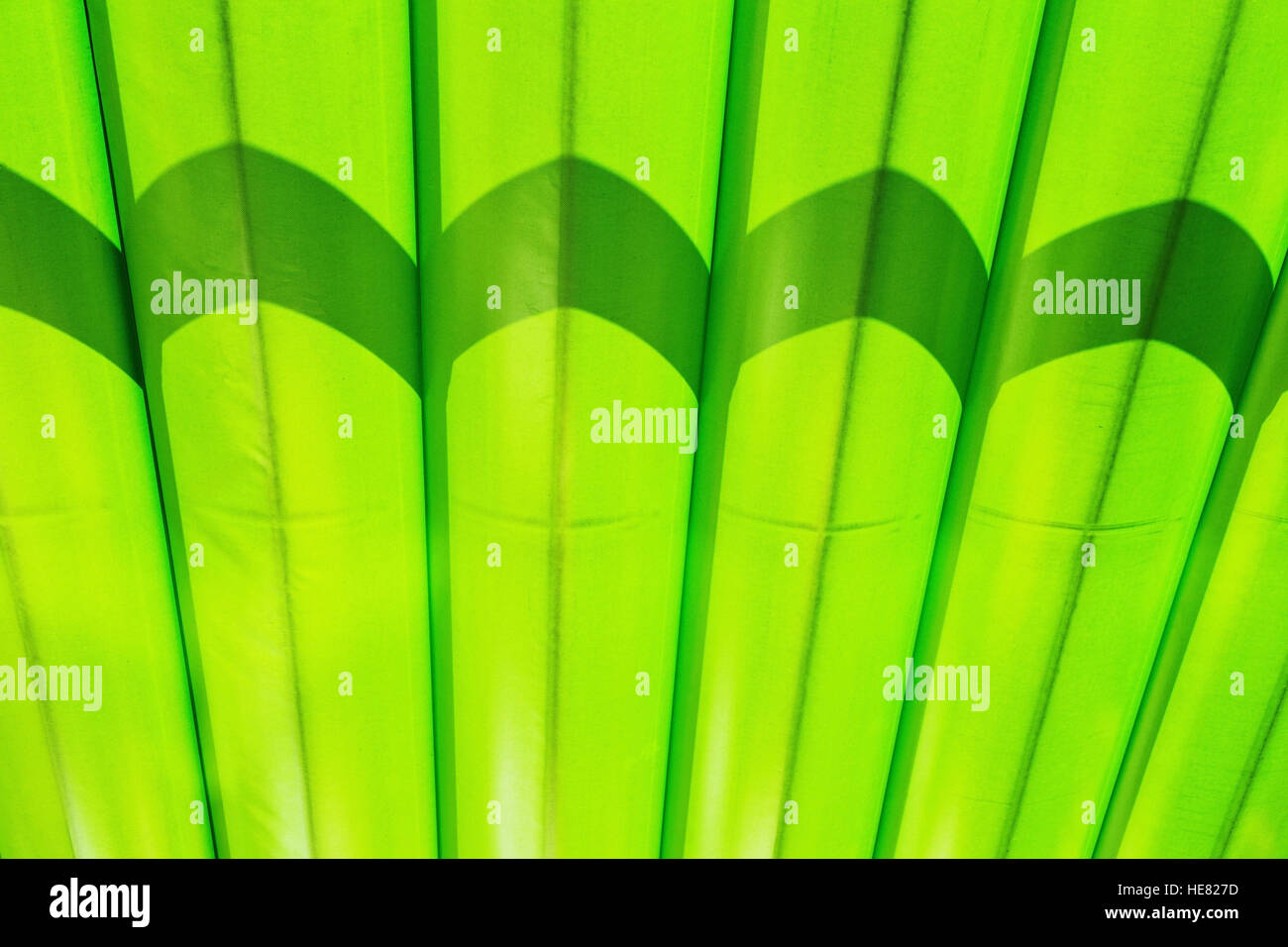 Fragment of green canvas striped marquee roof - Stock Image