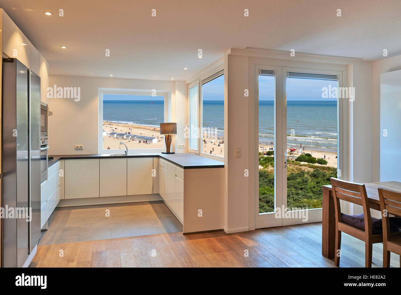 modern kitchen in renovated house with view on beach at summer Stock Photo
