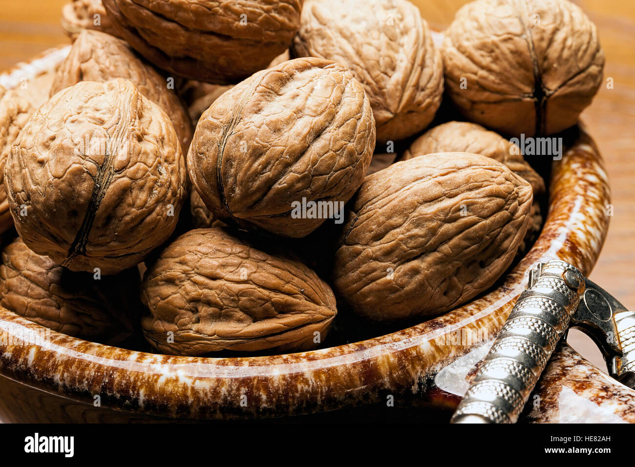 Close up of unshelled walnuts. Stock Photo