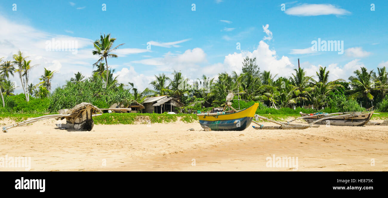 Fishing boats on a tropical beach Stock Photo
