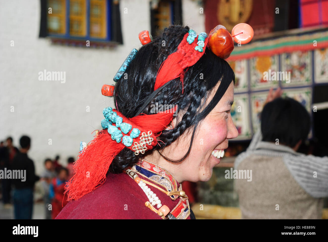 Lhasa: Jokhang Temple; Tibetan woman, headdress of turquoise, coral, amber and pearls worn at festivals like the - Stock Image