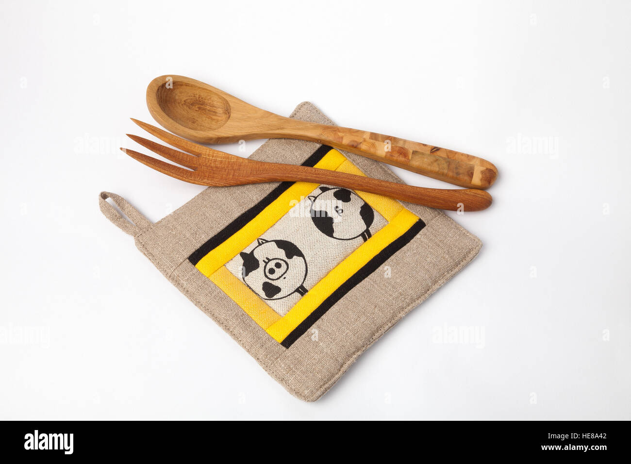 Kitchen utensils - linen potholder, wooden tools isolated on white. - Stock Image