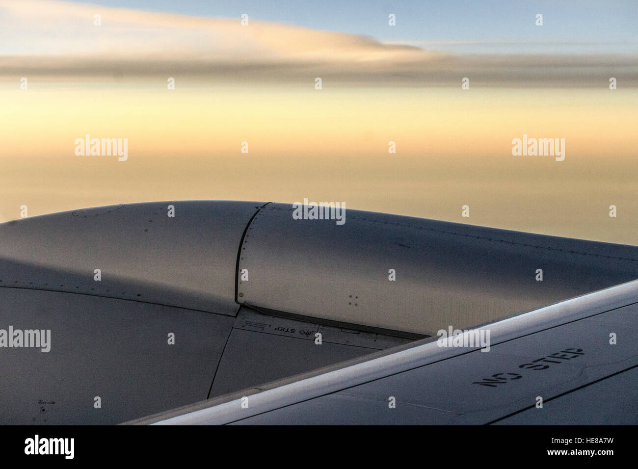 abstraction of engine & leading edge of wing Boeing Dreamliner in flight above Gulf of Mexico seen against beautiful - Stock Image