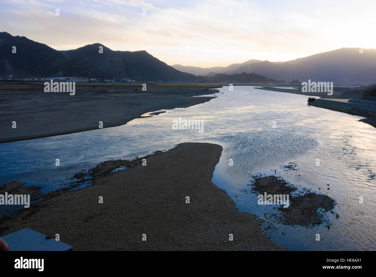 Lhasa: River Kyichu overlooking the railway station at sunset, Tibet, China Stock Photo