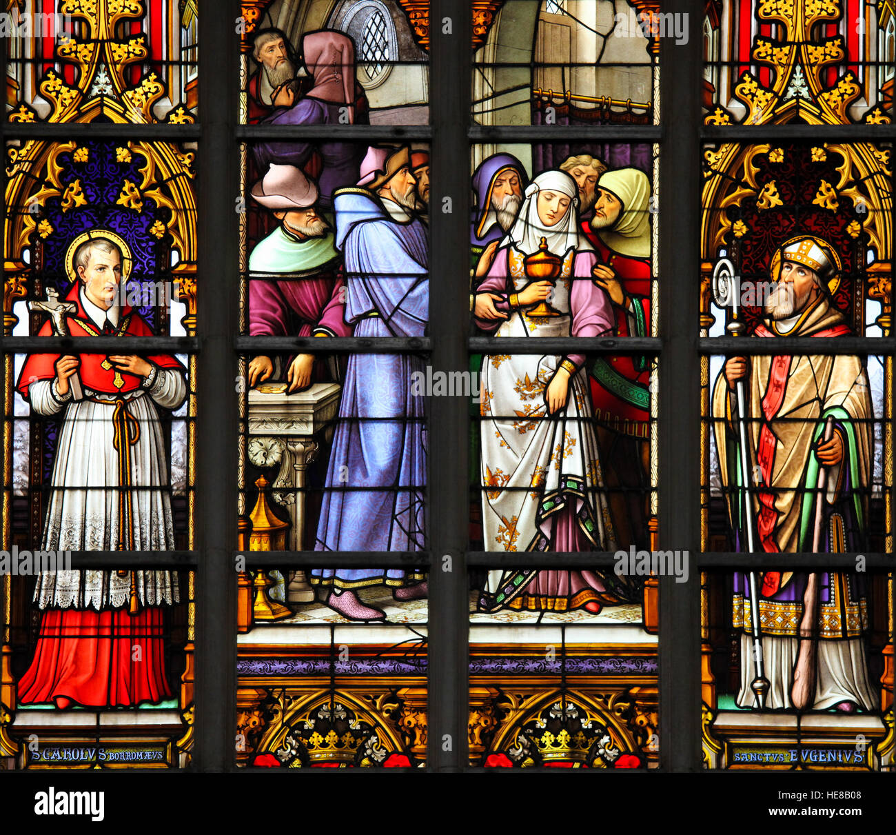 Stained Glass depicting the antisemitic legend of desecrated sacramental bread, whereby a female Jewish convert - Stock Image