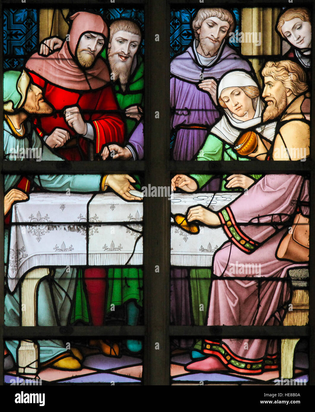 Stained Glass depicting the legend of Jews stealing sacramental bread, in the Cathedral of Brussels, Belgium. This - Stock Image