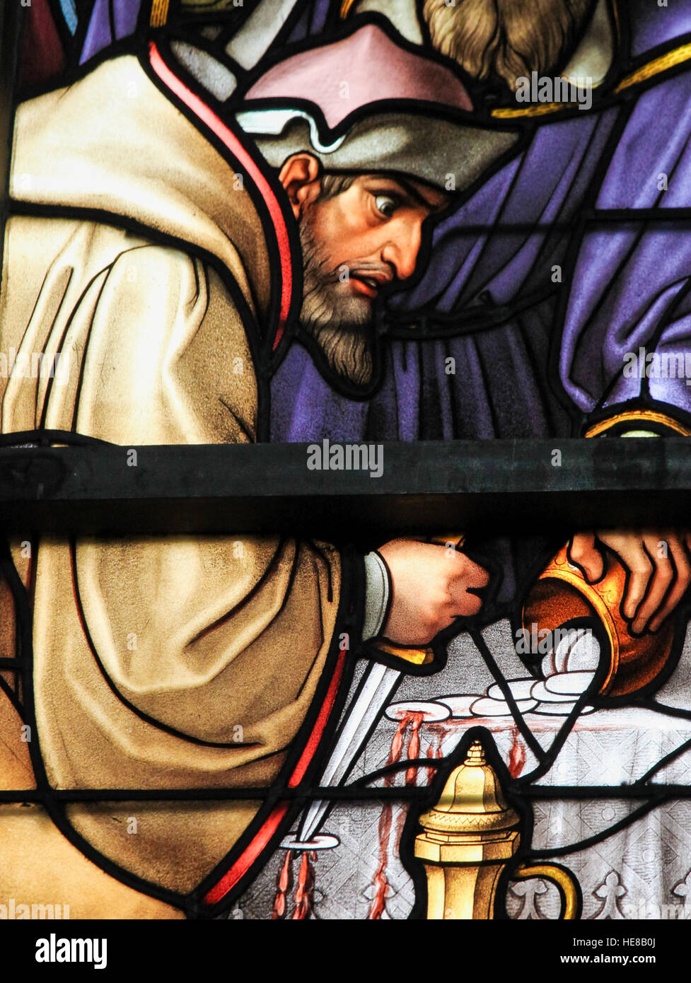 Stained Glass depicting the local legend of a Jew desecrating sacramental bread, in the Cathedral of Brussels, Belgium. - Stock Image