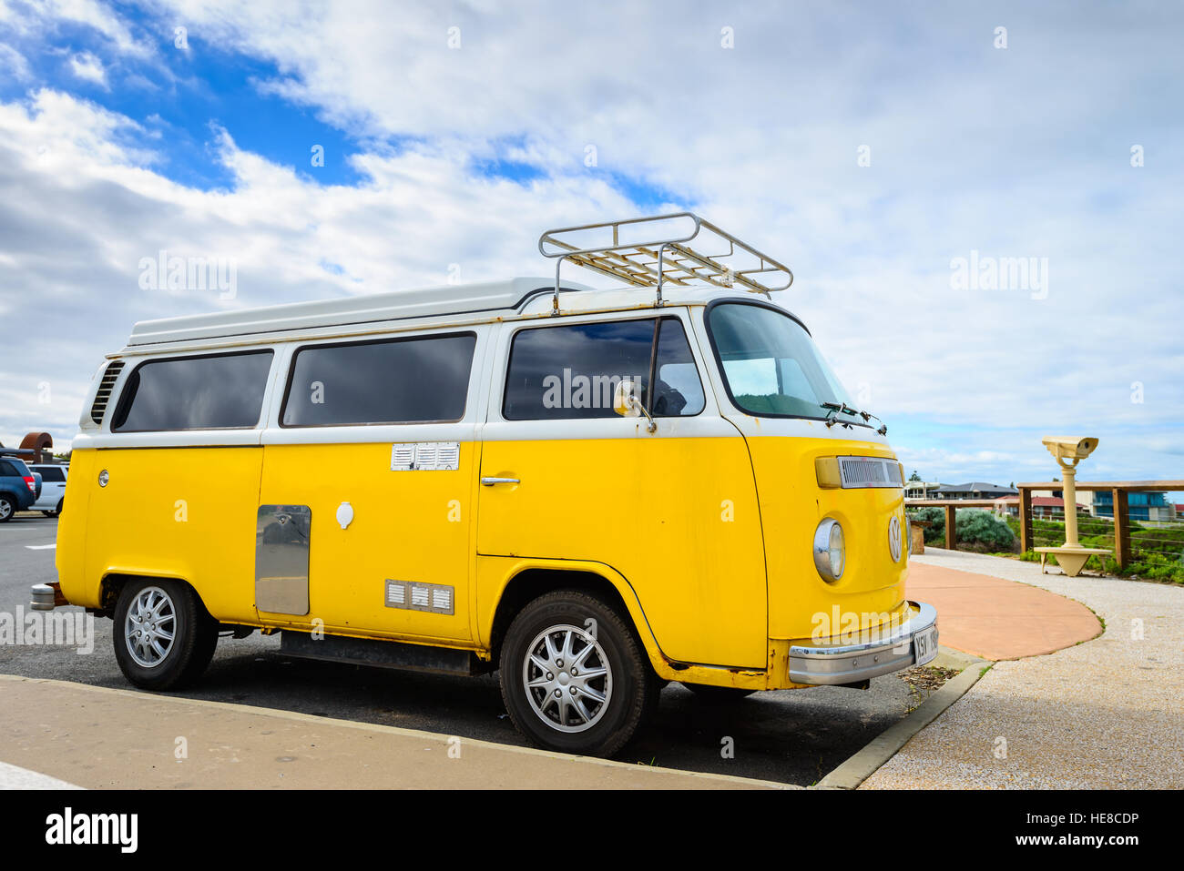 Adelaide, Australia - August 14, 2016: Classic yellow Volkswagen Transporter camper van parked on a street at Middleton - Stock Image