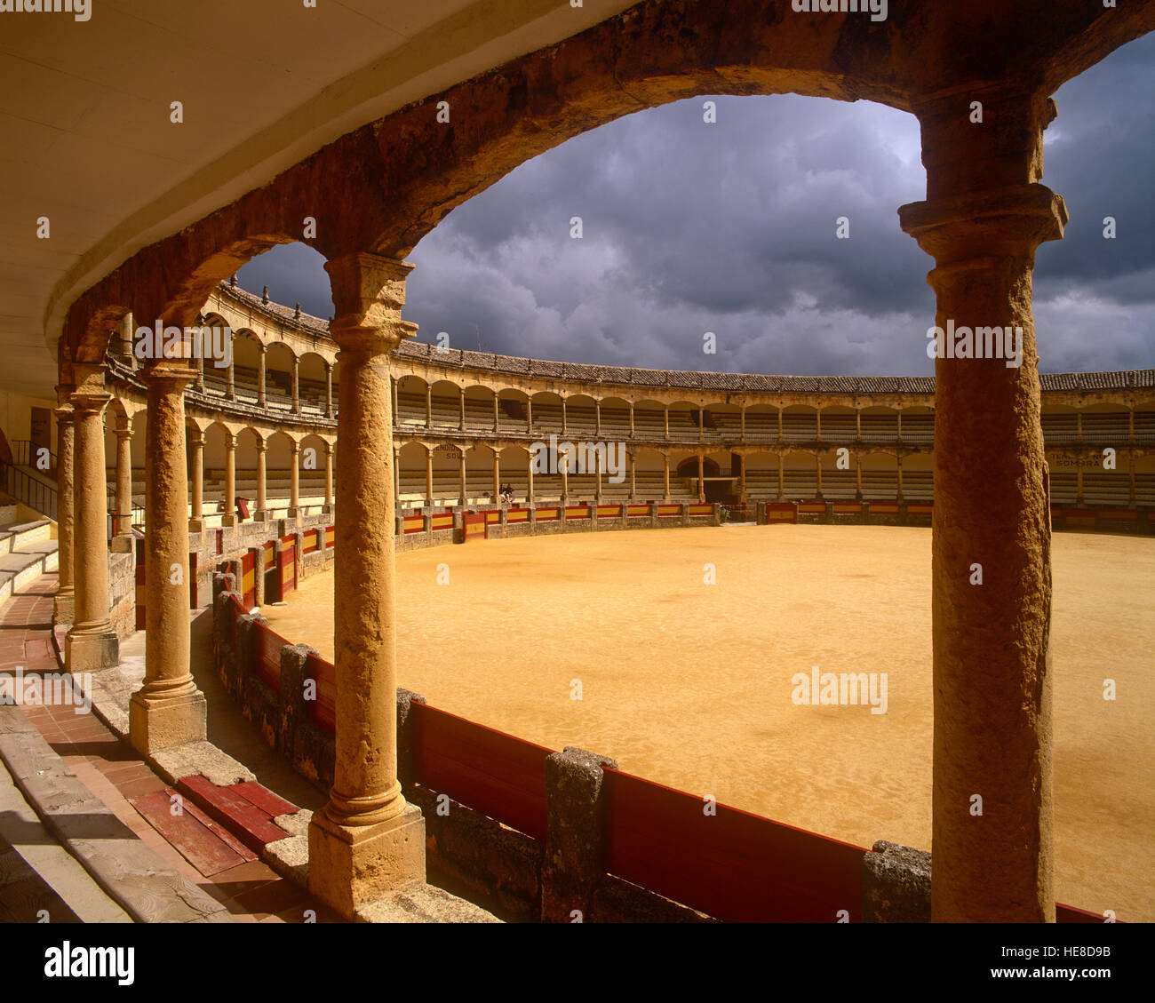 Ronda Bull Ring and storm clouds, Malaga Province, Andalusia, Spain. - Stock Image