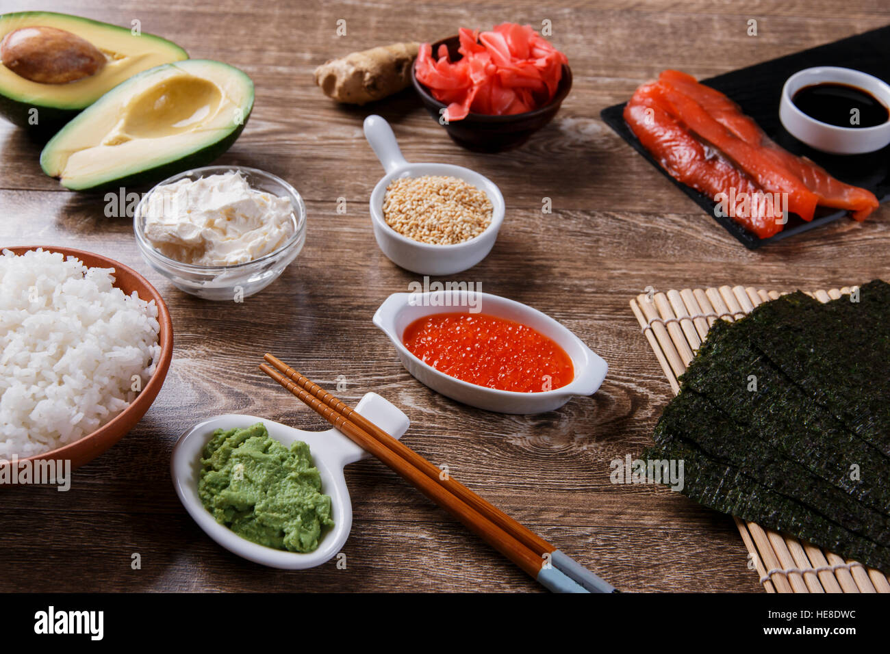 ingredients for sushi on a wooden table - Stock Image