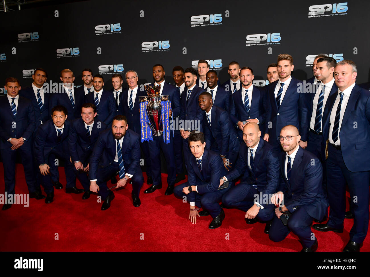 Leicester City football club with the Premier League trophy during the red carpet arrivals for BBC Sports Personality - Stock Image
