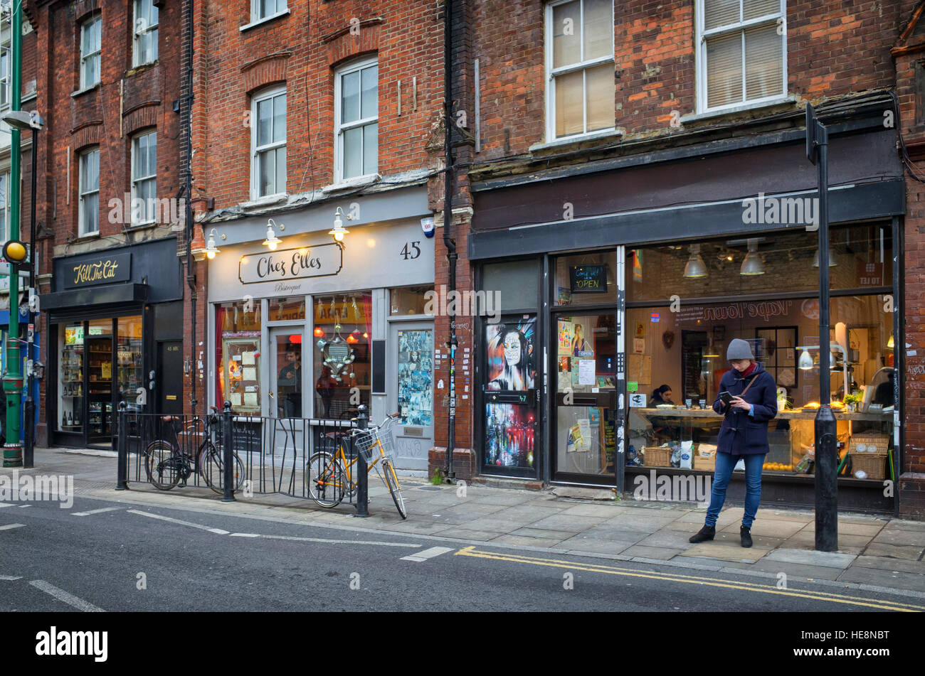 Brick Lane Spitalfields, new shops showing how the area is changing as gentrification moves in. - Stock Image
