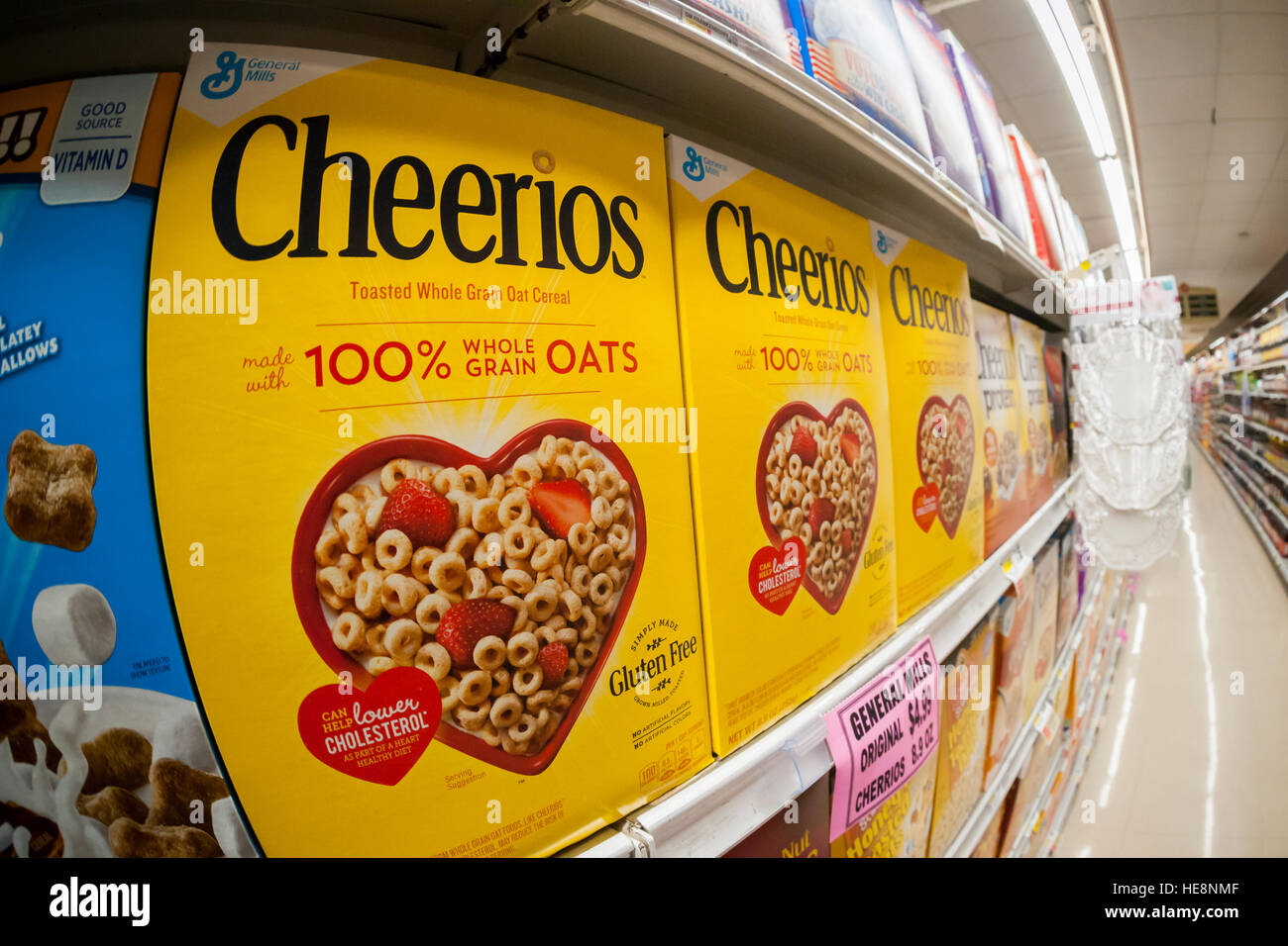 Boxes of General Mills' Cheerios breakfast cereal on supermarket shelves in New York on Friday, December 16, - Stock Image